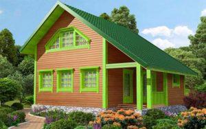 Дом из бруса с зеленой отделкой