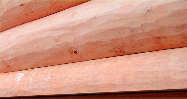 Особенности строительства дома из бруса лиственницы