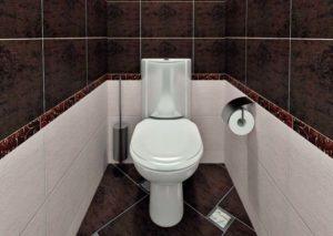 Унитаз и черный кафель в туалетной комнате