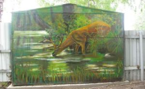 Гаражные вороты разрисованы динозавром