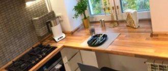 Дополнительное место для хранения посуды под подоконником вместо батарей.